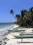 Philippine coastline. Fishing boats on Philippine coastline stock photo