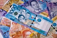 Philippine Currency. Philippine banknotes, 2010 issue, of various denominations with 1000 peso note on top royalty free stock photos