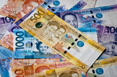 Philippine Currency. Philippine banknotes, 2010 issue, ov various denominations with 500 peso on top royalty free stock photography