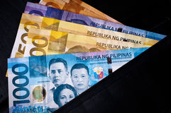 Philippine Currency. Philippine banknotes, 2010 issue, of various denominations, in a black wallet royalty free stock photography