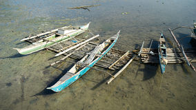 Philippine fishermen canoes Royalty Free Stock Photography
