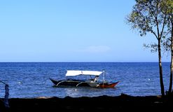 Philippine fishing boat standing in the sea off the coast royalty free stock image