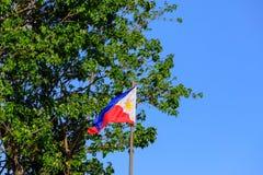 Philippine flag on blue sky. Philippine flag on clear blue sky stock photography