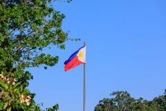 Philippine flag on blue sky. Philippine flag on clear blue sky stock photo
