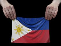 Philippine flag in hands. Image of Philippine flag in hands stock images