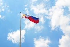 Philippine flag landscape. Flag of Philippines at luneta, rizal park waving against blue sky background stock image