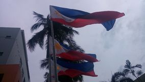 Philippine flag. Patriotic waving in the air. Cloudy background stock photo