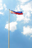 Philippine flag. Flag of Philippines at luneta, rizal park waving against blue sky background royalty free stock image