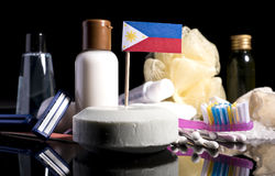 Philippine flag in the soap with all the products for the people Royalty Free Stock Images