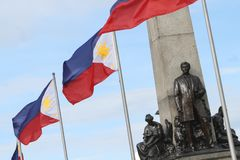 Philippine Landmark Rizal Monument. Philippine flags are seen fluttering at the monument of Philippine national hero, Jose P. Rizal, located in Rizal Park stock photos