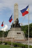 Philippine Landmark Rizal Monument. Philippine flags are seen fluttering at the monument of Philippine national hero, Jose P. Rizal, located in Rizal Park stock images