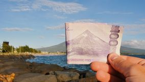 Philippine money. A Filipino monetary note in one hundred pesos is dedicated to the Mayon volcano. Philippine money. A Filipino monetary note in one hundred stock video