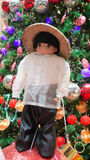 Philippine national custome. A doll dressed in Philippine national custome with the Christmas tree and Christmas balls in the background.  Photo taken on Royalty Free Stock Photos