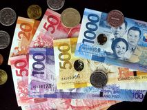Philippine peso bills and coins. Photo of Philippine peso bills and coins Royalty Free Stock Images