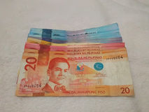 Philippine peso bills. Twenty pesos in front and also 50 pesos, 100 pesos, 500 pesos and 1,000 peso bills in line stock image