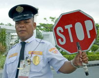 Philippine Police Officer Holding `Stop` Sign Stock Photo