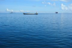 Freight ships on the horizon. The Philippine Sea with cargo ships Stock Photo