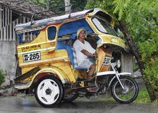 Philippine Tricycle. A young Philippine Tricycle driver in Digos City Philippines Stock Images