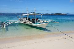 Philippines boat in crystal clear water Stock Photos