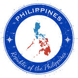 Philippines circular patriotic badge. Grunge rubber stamp with national flag, map and the Philippines written along circle border, vector illustration Stock Photography