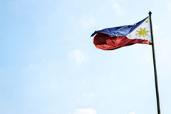 Philippines filipino flag on flagpole in manila Stock Images