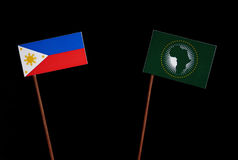 Philippines flag with African Union flag isolated on black Royalty Free Stock Photos