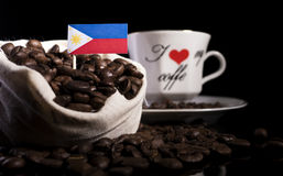 Philippines flag in a bag with coffee beans isolated on black. Background stock photos