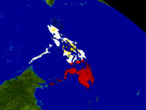Philippines with flag on Earth. Map of Philippines with embedded flag on planet surface. 3D illustration. Elements of this image furnished by NASA Royalty Free Stock Images