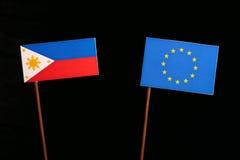 Philippines flag with European Union EU flag isolated on black. Background Stock Image