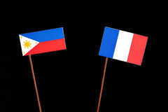 Philippines flag with French flag isolated on black Royalty Free Stock Photography