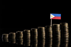 Philippines flag with lot of coins isolated on black Royalty Free Stock Photos
