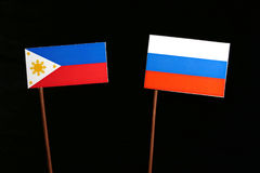 Philippines flag with Russian flag isolated on black Royalty Free Stock Photography