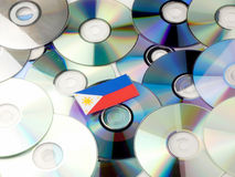Philippines flag on top of CD and DVD pile isolated on white. Philippines flag on top of CD and DVD pile isolated Stock Image