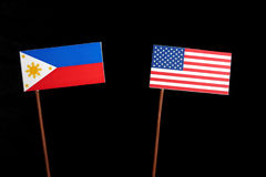 Philippines flag with USA flag isolated on black Stock Images