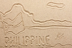 Philippines handwritten from  sand Royalty Free Stock Photo