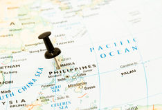 Philippines, manila map pin. Closeup shot of Phillippines map with black pushpin into its capital Manila, travelling concept stock image