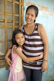 Portrait of a Happy Filipino Mother and Daughter Stock Image