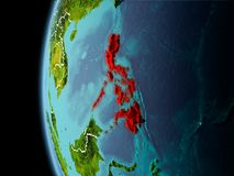 Philippines from space in evening. Evening over Philippines as seen from space on planet Earth with visible border lines and city lights. 3D illustration Stock Photo