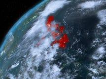 Philippines sur terre de planète dans l'espace la nuit Photo stock