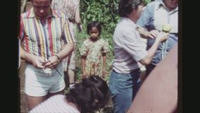 Woman Selling Pinapples. PHILIPPINES, TAGAYTAY CITY, APRIL 1978. Two Shot Sequence Of A Woman And Some Helping Girls, Selling Fresh Cut Pineapples To A Group Of stock video