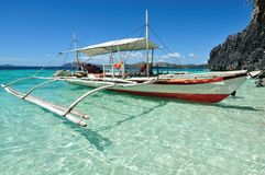 Philippines tent boat in crystal tropical sea stock photography