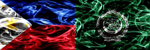 Philippines vs Arab League smoke flags placed side by side. Thick abstract colored silky smoke flags. Philippines vs Arab League smoke flags placed side by side royalty free stock photography