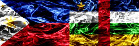 Philippines vs Central African Republic smoke flags placed side by side. Thick abstract colored silky smoke flags. Philippines vs Central African Republic smoke royalty free stock photo