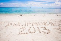Philippines written in a sandy tropical beach Stock Photo