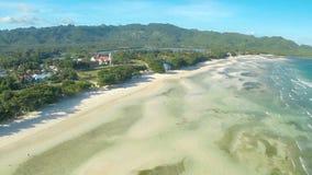 Philippinischer Strand Schattenbild des kauernden Geschäftsmannes Anda-Stadt stockfoto