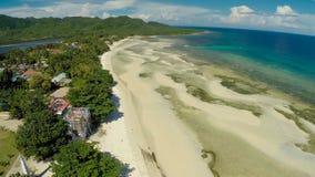 Philippinischer Strand Schattenbild des kauernden Geschäftsmannes Anda-Stadt stockfotografie