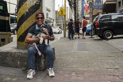 Philippino man with his dog. Royalty Free Stock Photography