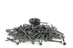 Philips head driver on a pile of screws stock images