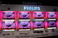 Philips plasma. Wall of plasma televisions Philips in the electronics section of store Royalty Free Stock Photography