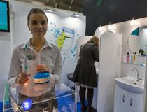 Philips Sonicare electric toothbrush booth during CEE 2017 in Kiev, Ukraine. People visit Philips Sonicare electric toothbrushes manufacturer booth during CEE Stock Image